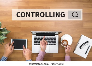 CONTROLLING Two Businessman working at office desk and using a digital touch screen tablet and use computer