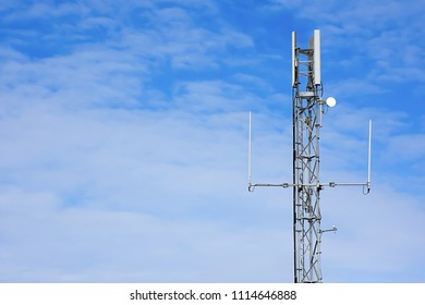Controversial 5G antenna mast against blue sky with copy space.Wirless network mast  in rural Britain.Connectivity UK.Burning issue.Outdoor wifi internet station.Modern technology.