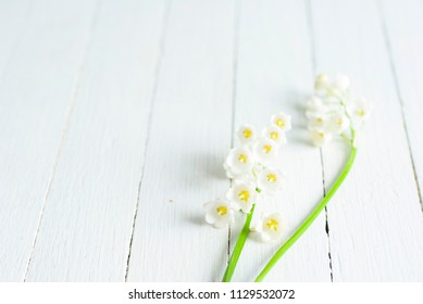 convallaria flowers on white wood table, wedding background