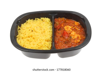 Convenience food, chicken curry and pilau rice in a plastic carton isolated against white