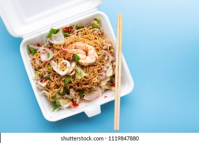 Convenience food in take away foam product. Unhealthy lunch box. Instant noodle spicy seafood salad