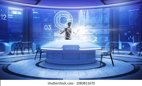 Convenient workplace. Calm clever software developer working in a futuristic comfortable office while standing in front of a transparent screen