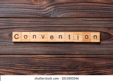 convention word written on wood block. convention text on cement table for your desing, concept.