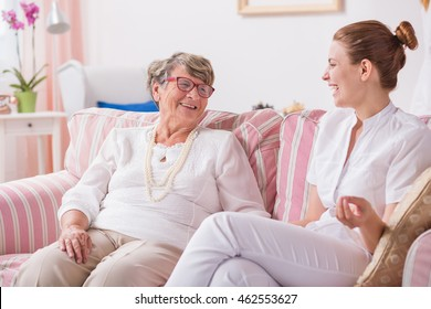 Conversation between senior woman and young smiled nurse