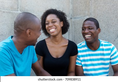 Conversation of three african men and woman
