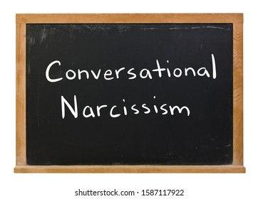 Conversational Narcissism written in white chalk on a black chalkboard isolated on white