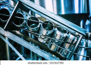 Conveyor belt with beer cans. Production of beer beverage, beverage bottling in banks. Tightening the lids on the aluminum beer can