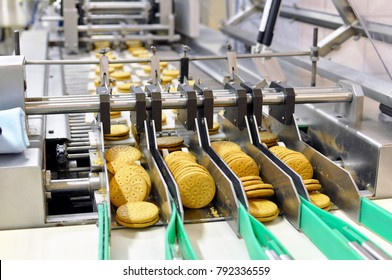 conveyor belt with biscuits in a food factory - machinery equipment  - Shutterstock ID 792336559