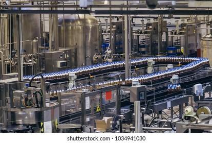 Conveyor belt of brewery production line . Beer polyethylene PET bottles are moving on conveyor.