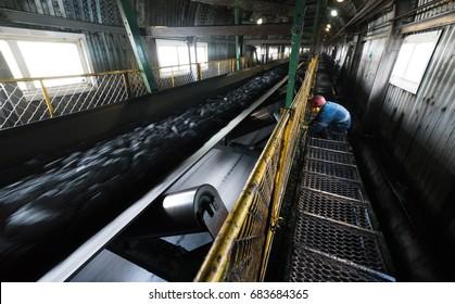 Conveyor belt with coal. The coal conveyor. Mining
