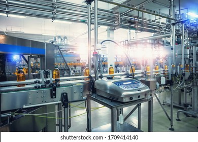 Conveyor belt, filled bottles on beverage factory, industry production line.
