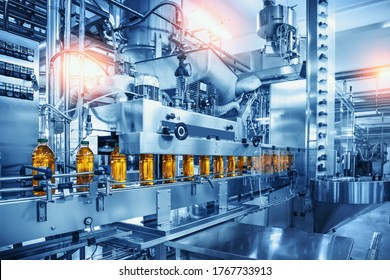 Conveyor belt with juice bottles on beverage factory interior in blue color. - Shutterstock ID 1767733913