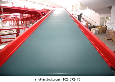 Conveyor Belt Loading Ramp in Sorting Warehouse
