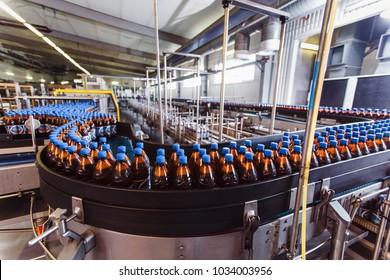 Conveyor belt with plastic bottles in the beer factory