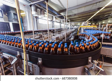 Conveyor belt with plastic bottles in the beer factory