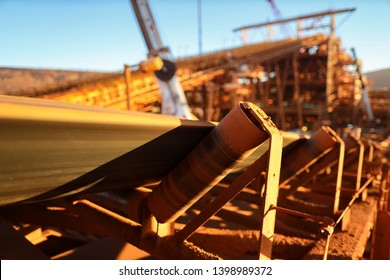 Conveyor belt and rollers structures line its transfer iron ore into material screen house construction mine site, Sydney, Australia