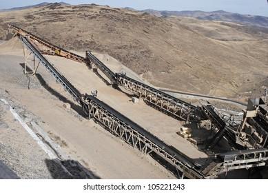 Conveyor belts for crushed roadstone at asphalt manufacturing.