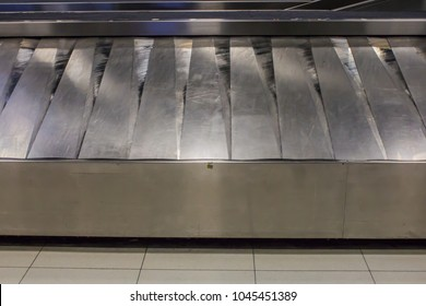 conveyor belts transport luggage in the airport.