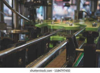 Conveyor for bottling and packing bottles in the factory.