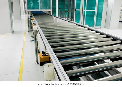 The conveyor chain, and conveyor belt is on production line in clean room.
