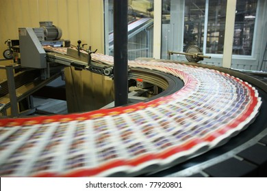 The conveyor with magazines.  Printing factory. A stream of journal production.