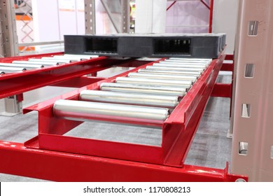 Conveyor Roller with pallet ; warehouse system