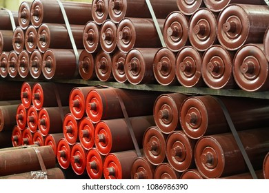 Conveyor rollers, drive drums, tensioning station