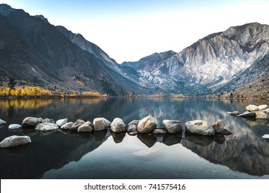 Convict Lake at sunrise in the fall, with calm water. This mountain lake is located in California's eastern Sierra Nevada, near the town of Mammoth Lakes