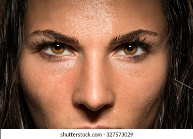 Conviction focused determined passionate confident powerful eyes stare intense athlete exercise trainer