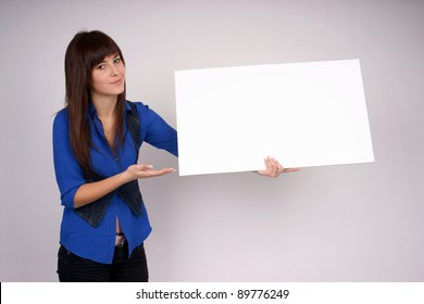 Convincing woman pointing at blank banner.