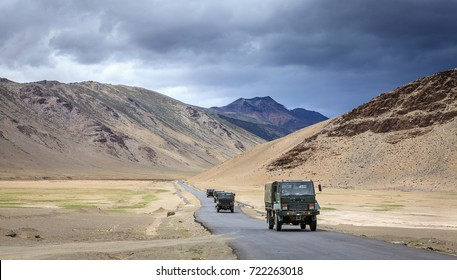 Convoy of military trucks is moving through Changthang plateau in Ladakh region of Kashmir, India.