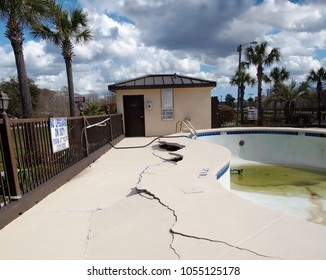 CONWAY, SOUTH CAROLINA - FEBRUARY 23, 2018: An above ground swimming pool and it's surrounding concrete patio are in disrepair after a flood has damaged the area.