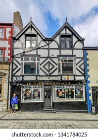 CONWY, WALES - MARCH 13, 2019: A street view of a public house in the coastal town of Conwy, in North Wales