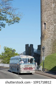 CONWY WALES, MAY 5 2018 1958 Seddon Mark 19 coach on a vintage tour passing Conwy Castle.