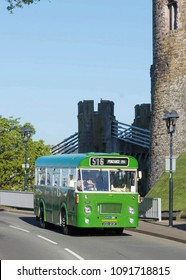 CONWY WALES, MAY 5 2018 1972 Bristol LHS bus on a vintage tour passing Conwy Castle.