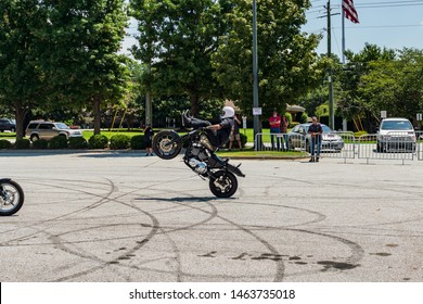 conyers georgia/usa-july 27 2019 a guy riding a wheelie with his feet out