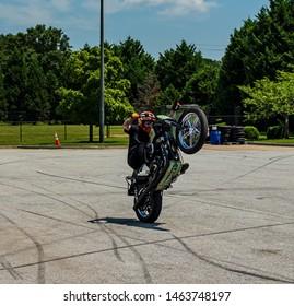 conyers georgia/usa-july 27 2019 a guy riding  a wheelie