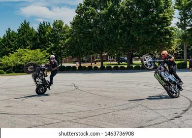 conyers georgia/usa-july 27 2019 Two guys riding wheelies on motorcycles