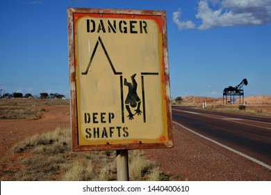 COOBER PEDY, SA -MAY 21 2019:Historic old Opal Mine shaft warning sign in Coober Pedy in South Australia.Coober Pedy town supplying most of the world's gem-quality opal.
