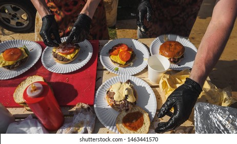 Coocking bbq beef burgers in summer festival.