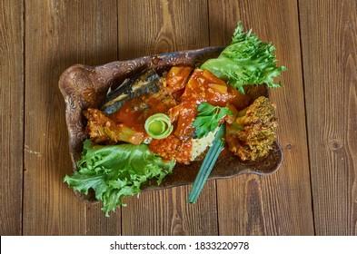 Coo-Coo and Flying Fish, national dish of Barbados,  cornmeal and okra porridge