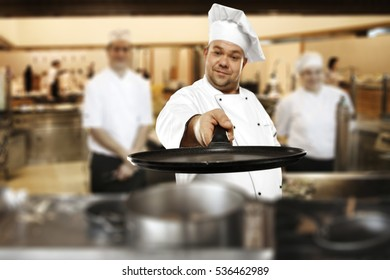 Cook chef in kitchen