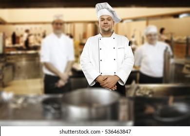 Cook chef in kitchen interior