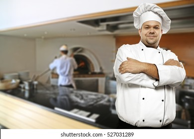 Cook chef in kitchen and work time