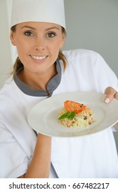 Cook chef presenting dish to camera