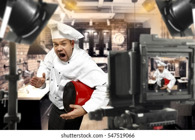 Cook chef in tv studio with camera and lamps makes a show of skills