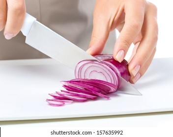 Cook is chopping onion, closeup shoot, isolated over white