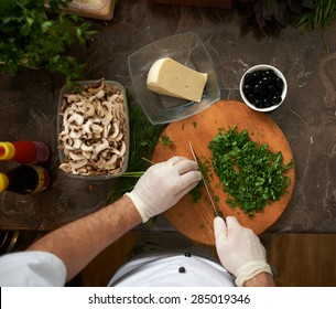 Cook chops parsley first-person view