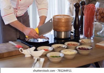 cook cooks scrambled eggs in a restaurant