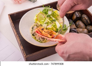 The cook a fork gets meat of the baked crab from an armor
